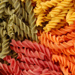 Colored twirls pasta background — Stock Photo
