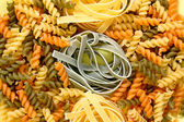 Fusilli and tagliatelle pasta — Stock Photo