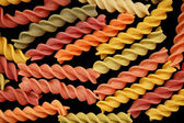 Fusilli pasta food background — Stock Photo