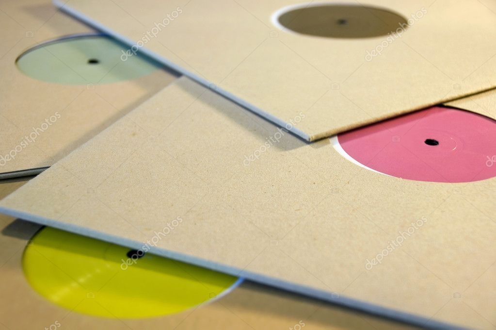 Pile of cardboard sleeve vinyl music records with colorful blank labels. — Stock Photo #2407098