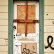 Boarded up door - Stock Photo