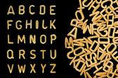 Alphabet soup nudeln schriften — Stockfoto