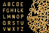 Alphabet soup pasta font — Photo