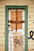 Boarded up door — Stock Photo