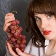 The girl with grapes — Stock Photo