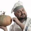 The cook holds a pumpkin — Stock Photo