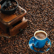 Cup of coffee and coffee-mill — Stock Photo