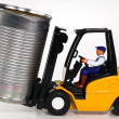 Forklift and tin can — Stock Photo