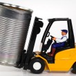 Stock Photo: Forklift and tin can