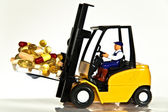 Fork lift and tablets — Stock Photo