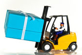Forklift and present — Stock Photo