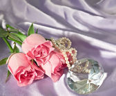 Rosebuds and diamond and pearls — Stock Photo