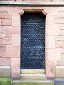 An ancient black studded door — Stock Photo