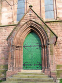 An imposing door with metal studs — Stock Photo