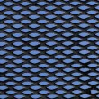 Metal grid over blue background — Stock Photo