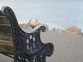 Old wooden bench on the wharf — Stock Photo