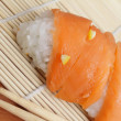 Stock Photo: Salmon sushi on bamboo mat