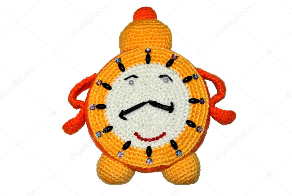 Knitted handwork in the form of ridiculous children's alarm clock
