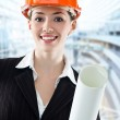 A beautiful young architector in a hardhat — Stock Photo #1642712