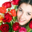 Girl and roses - Stock Photo
