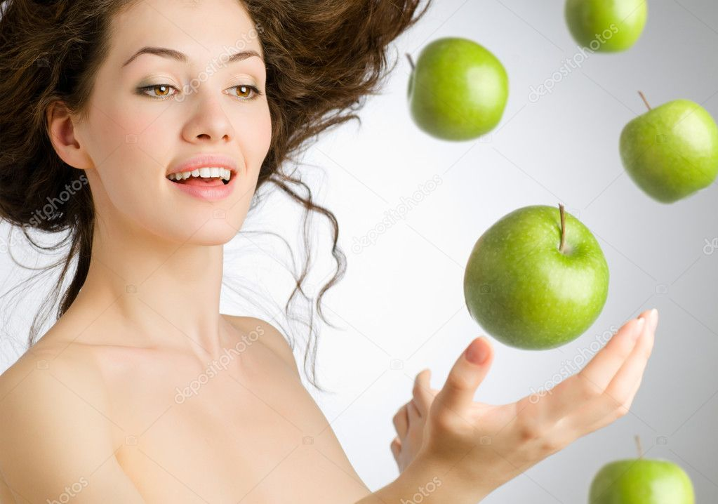 A girl with a ripe green apple  Foto Stock #1640633