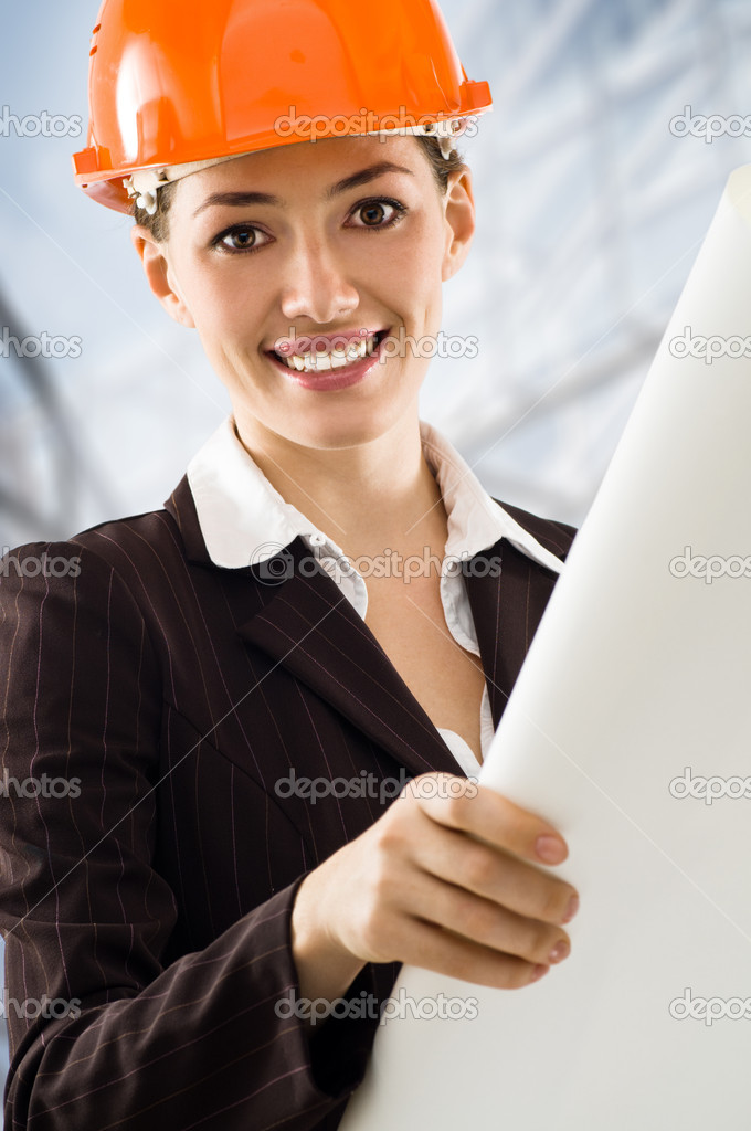 A beautiful young architector in a hardhat — Stock Photo #1642700