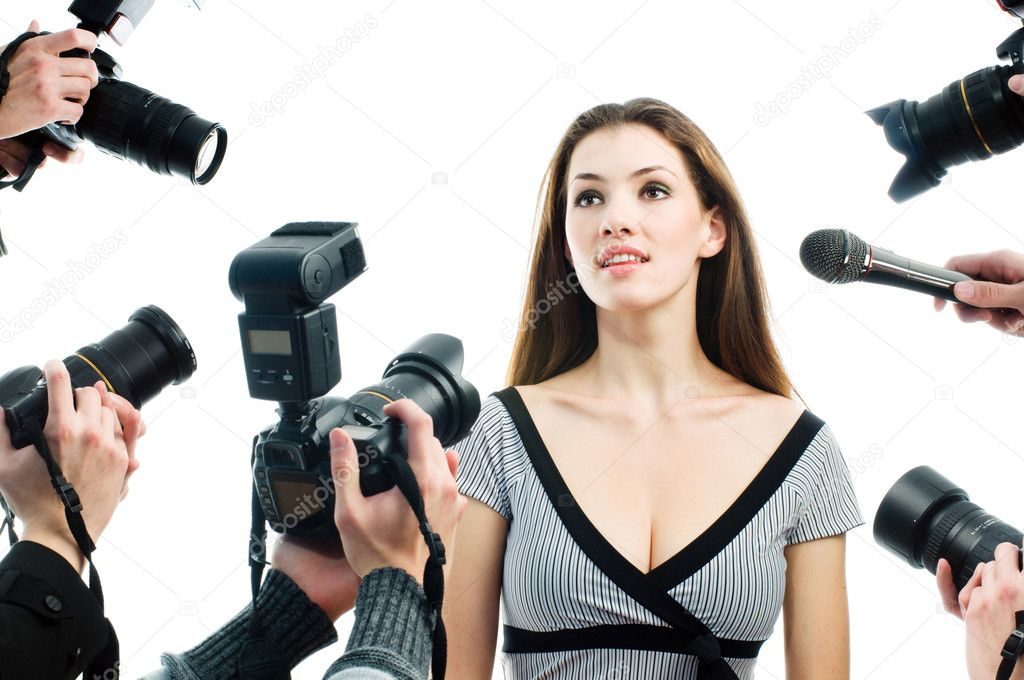 Photographers are taking a picture of a film star  — Stock Photo #1699074