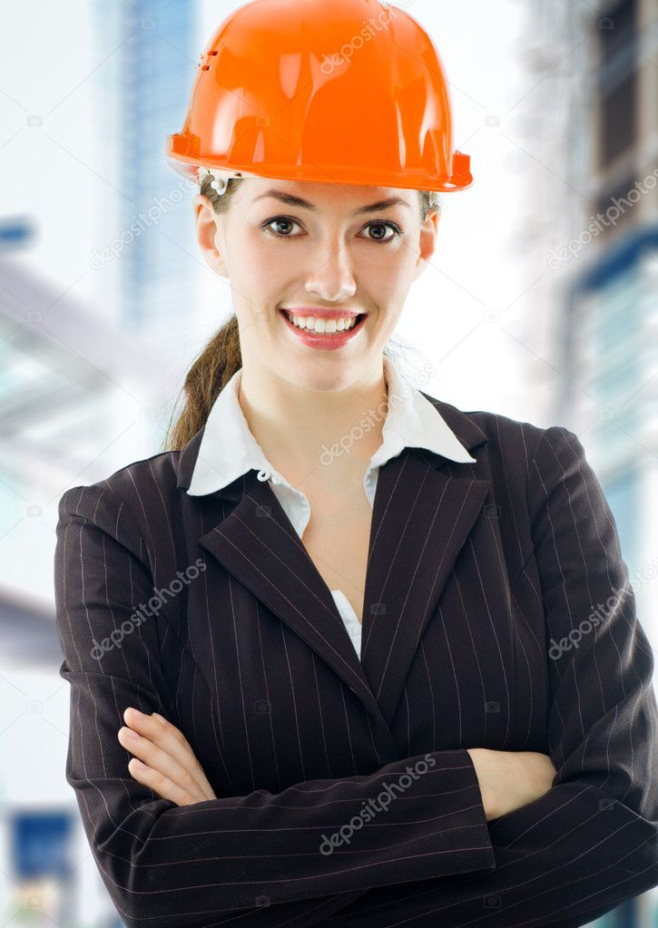 A beautiful young architect in a hardhat — Stok fotoğraf #1699320
