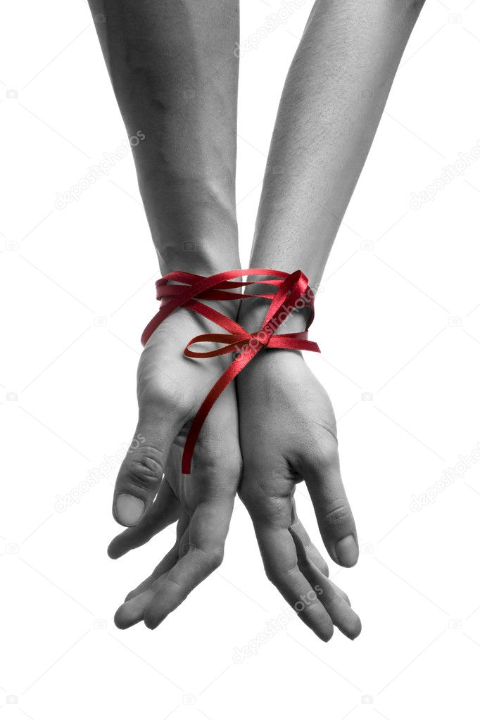 Mans and  girls hands tieing with ribbon  — Stock Photo #1699429