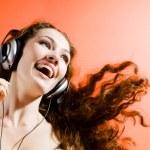 Girl in headphones — Stock Photo #1716116