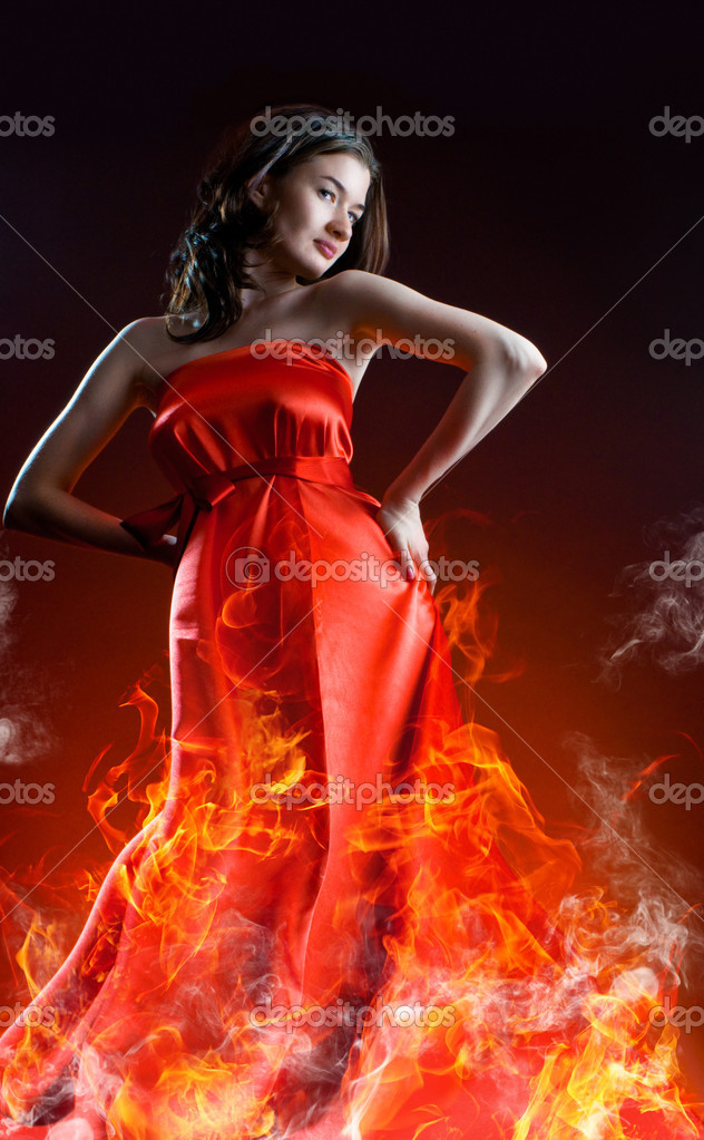 Beautiful young woman in red long dress — Stock Photo #1716647