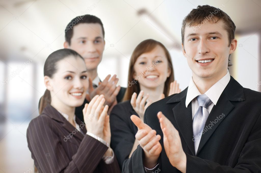 Team of successful smiling young business — Stock Photo #1716737