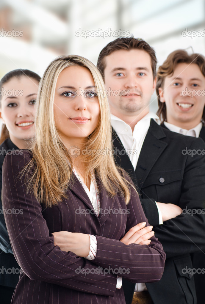 Team of successful smiling young business — Stock Photo #1723451