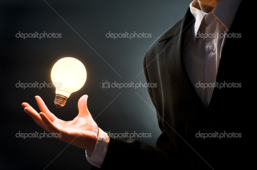 A man pointing to the illuminated bulb  Lizenzfreies Foto #1723748