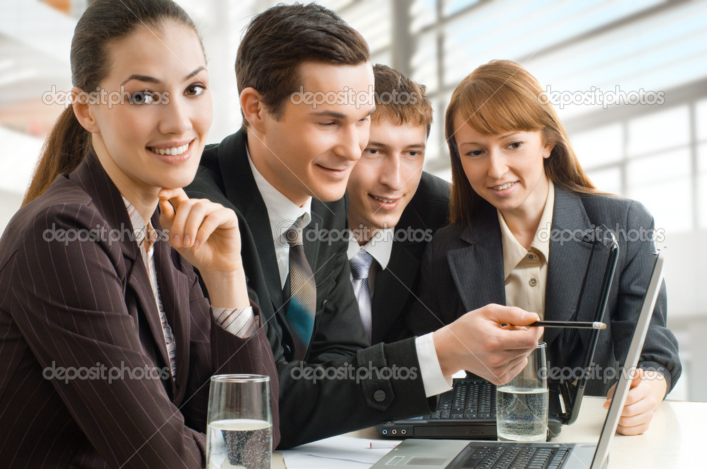 Team of successful smiling young business — Stock Photo #1744002