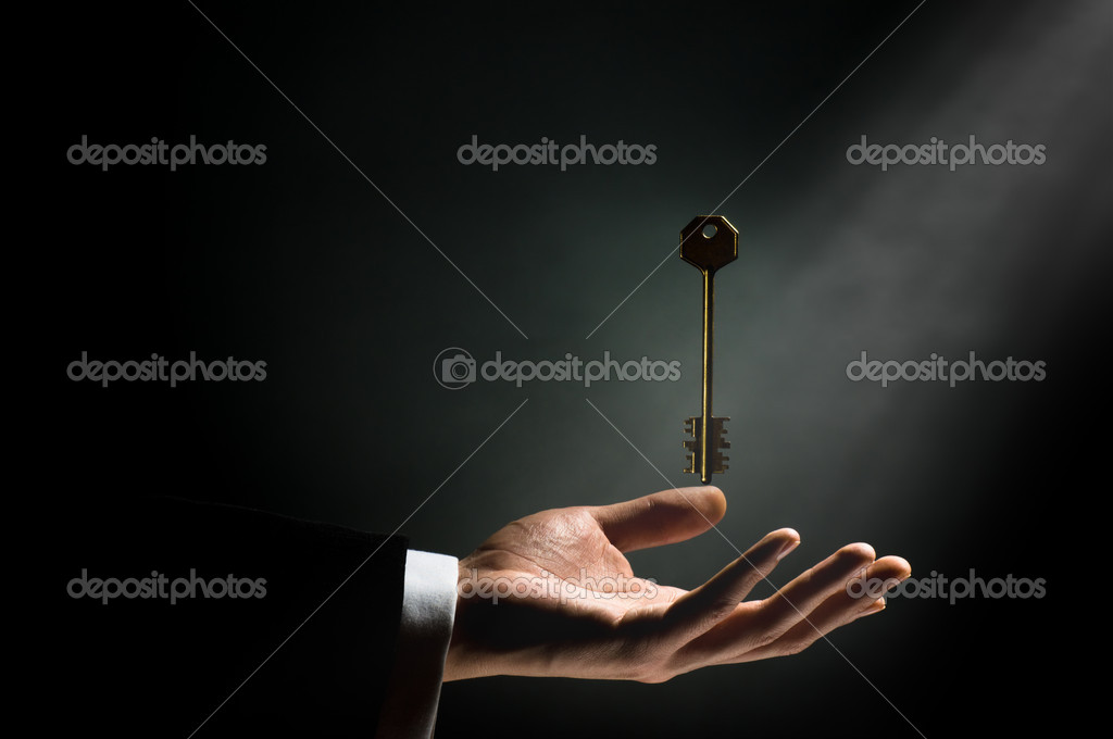 A man pointing to the gold key — Stock Photo #1744171
