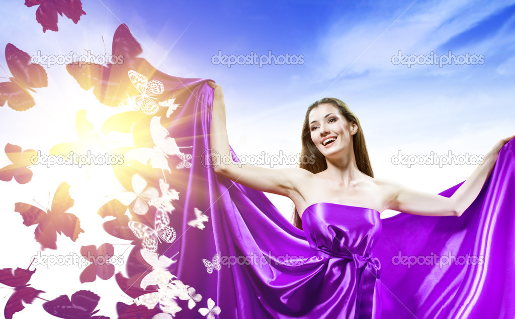 Beautiful young woman in purple long dress — Stock Photo #1744724