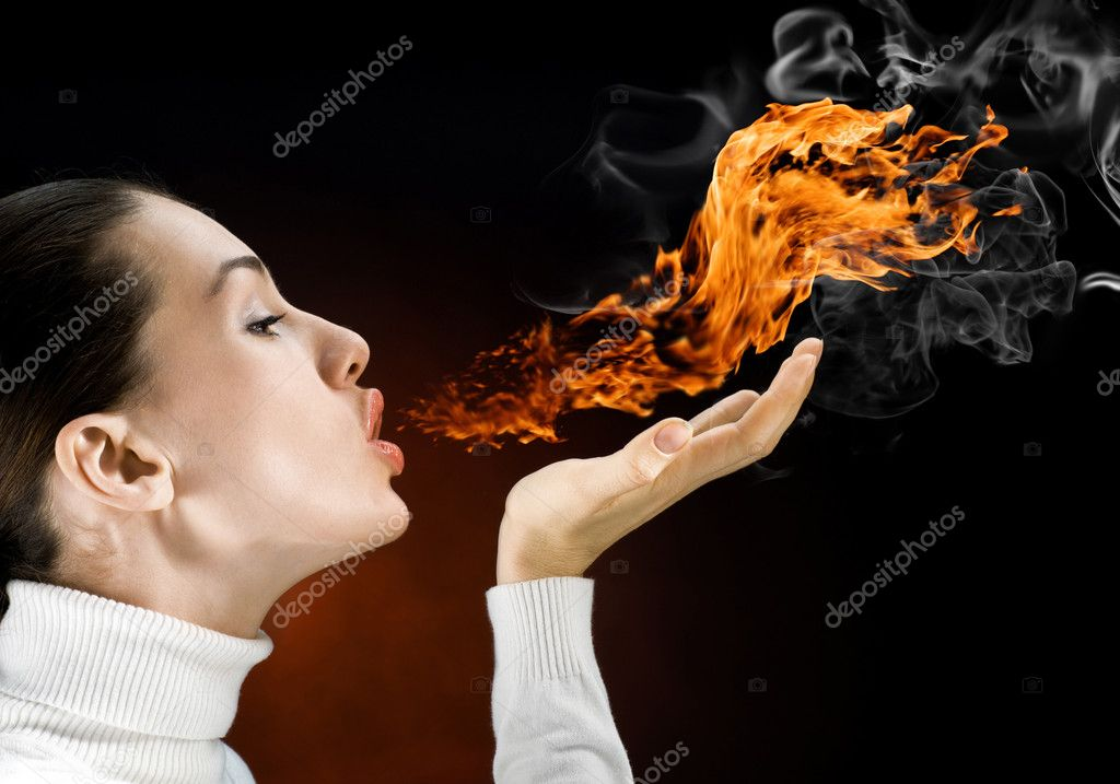 Angry gorgeus girl in the burning flame — Stock Photo #1745398