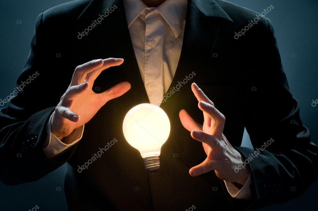 A man pointing to the illuminated bulb — Stock Photo #1760968