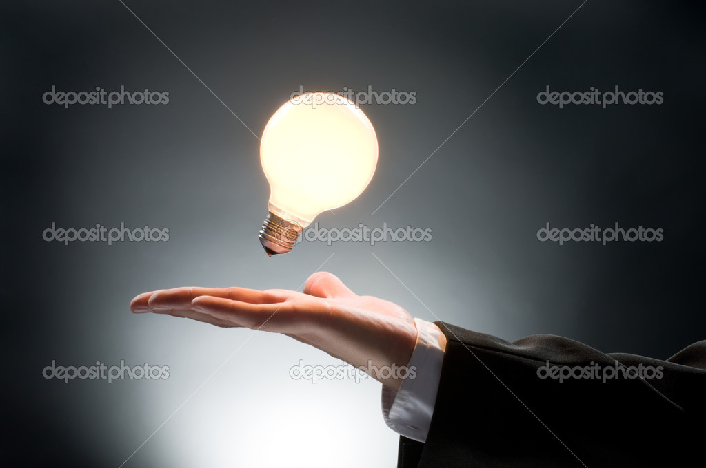 A man pointing to the illuminated bulb  Stock Photo #1760976