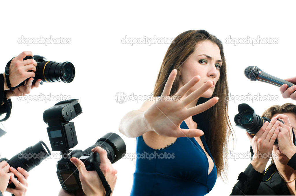 Photographers are taking a picture of a film star  — Stock Photo #1763630