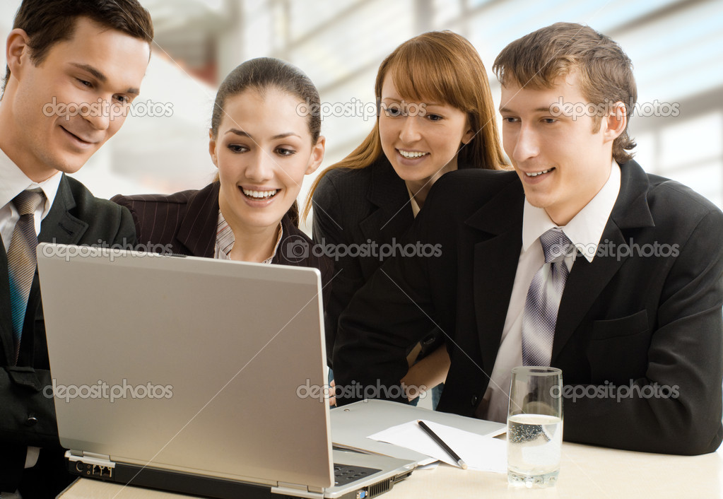Team of successful smiling young business — Stock Photo #1787920