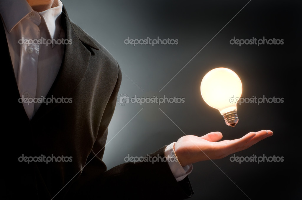 A man pointing to the illuminated bulb — Stock Photo #1788124