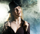 Girl in the smoke — Stock Photo
