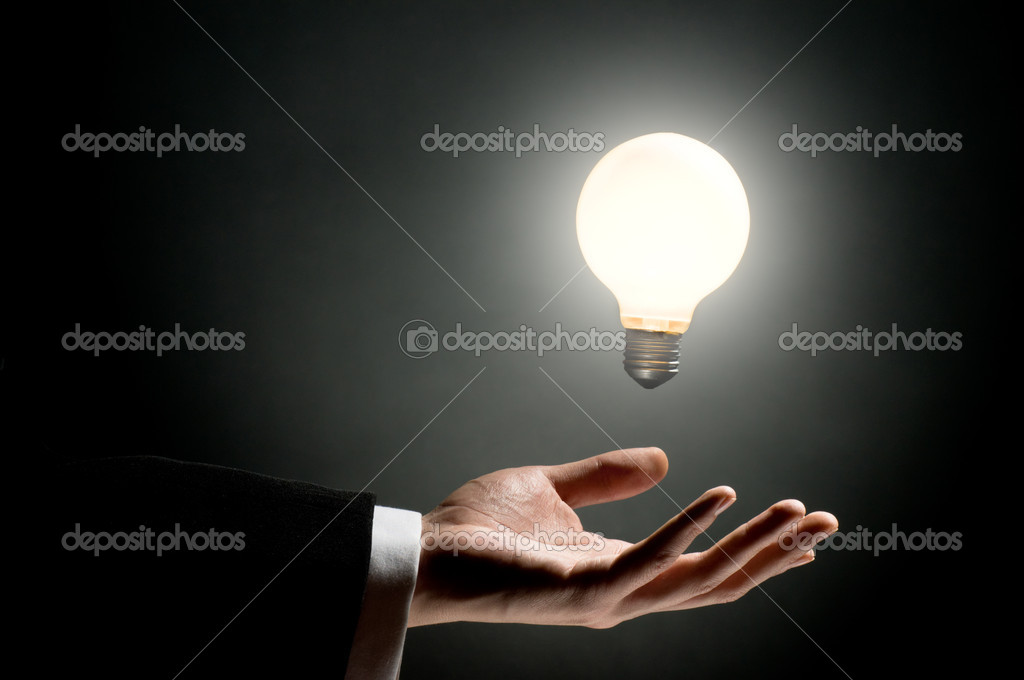 A man pointing to the illuminated bulb — Stock Photo #1806022