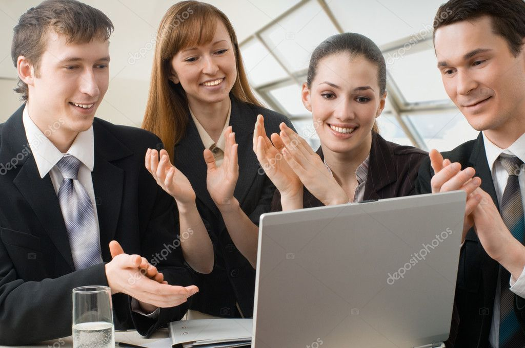 Team of successful smiling young business — Stock Photo #2046148