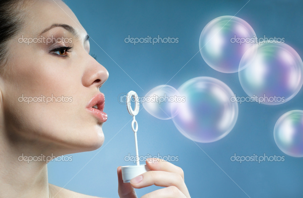 A beauty young woman blowing soap bubbles  Stock Photo #2050158