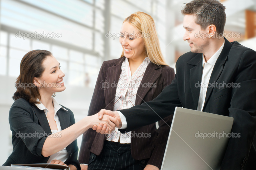 Team of successful smiling young business — Stock Photo #2607430