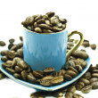 Stock Photo: Cup with seeds of coffee