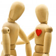 Loving couple of wooden dummies — Stock Photo